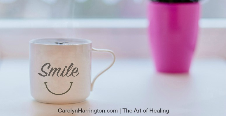 A mug with the word smile on it