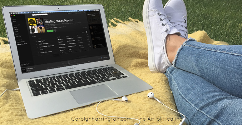 Playlist on Laptop outdoors